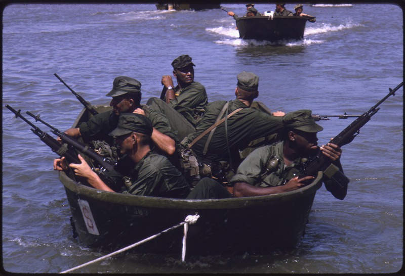 US Marines in Groups of 4 to 5 on Outboard Motorboats